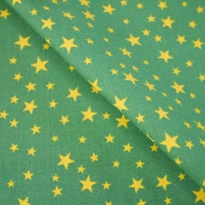 Polycotton - Scattered Stars Yellow On Dark Green