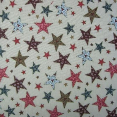 Cotton Fabric - Festive Stars Multi On Peach