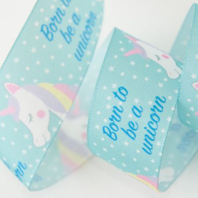 Berisfords Born To Be a Unicorn Ribbon On Teal - 25mm Wide